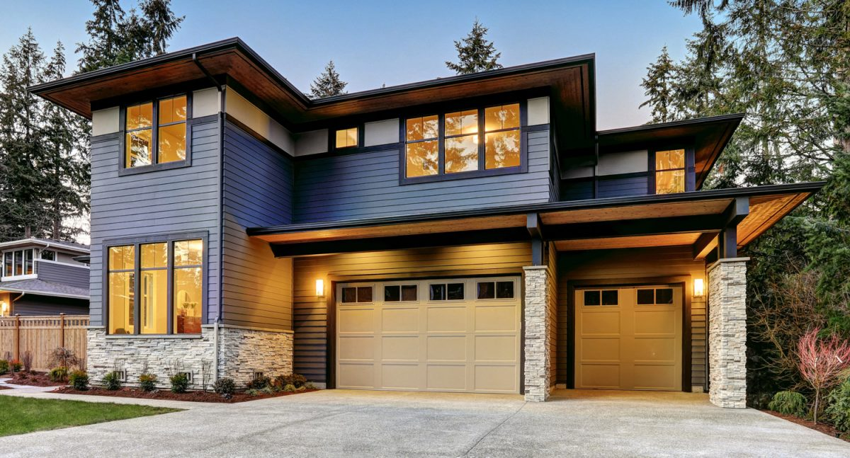 A blue two story modern home; sell your home with Rival Realty Group