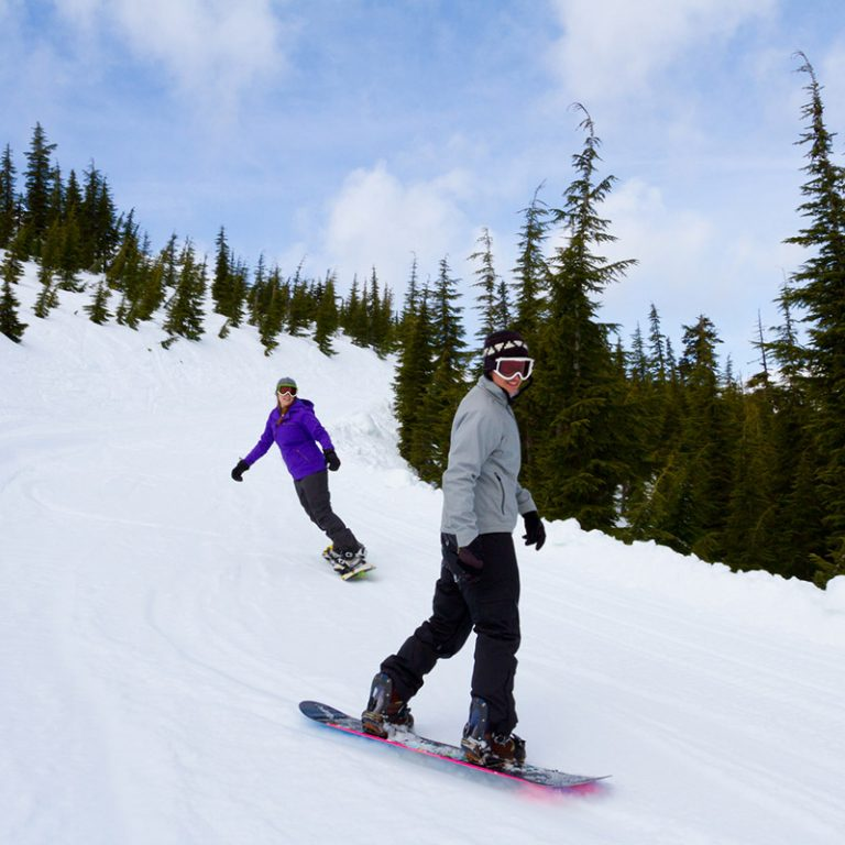 Two snowboarders in Hoo-Doo Sno Park
