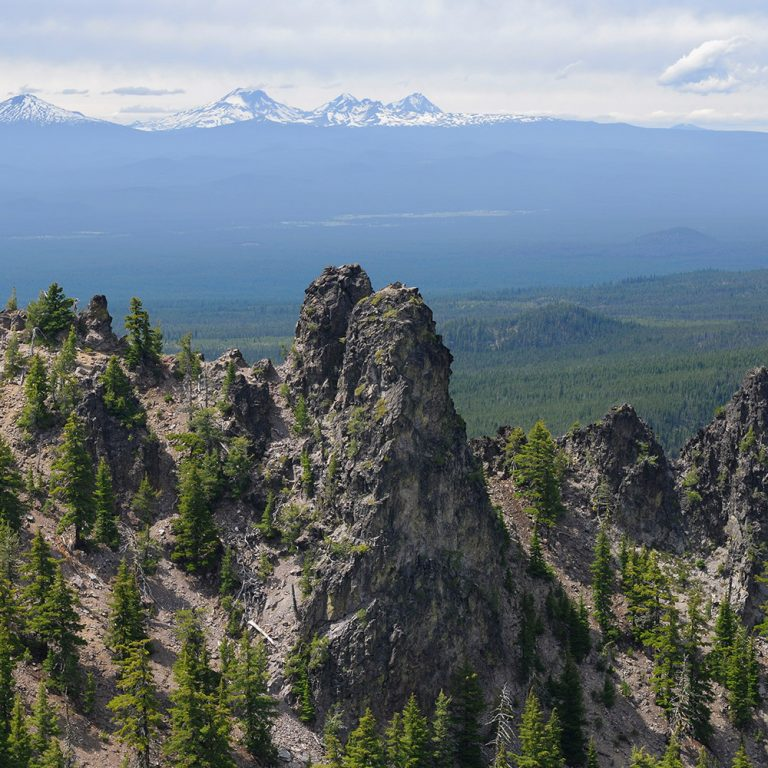 View of Paulina Peak Oregon with snowy mountains in the distance