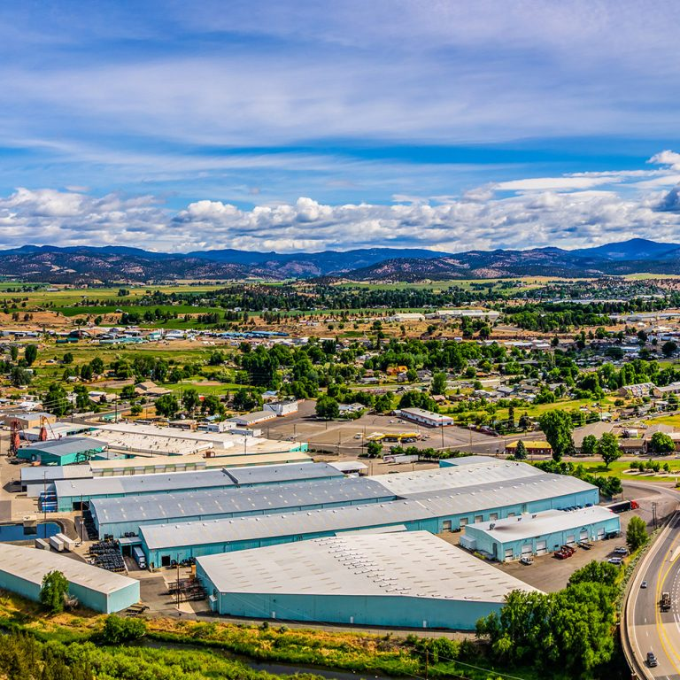 Aerial View of Prineville, Oregon with blue skies and fluffy white clouds