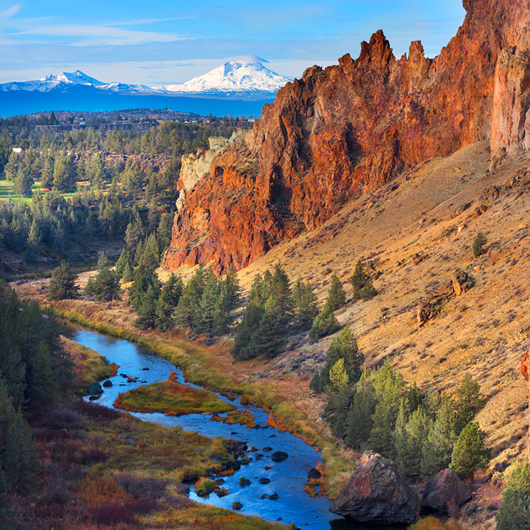 A winding river flows past Smith Rock