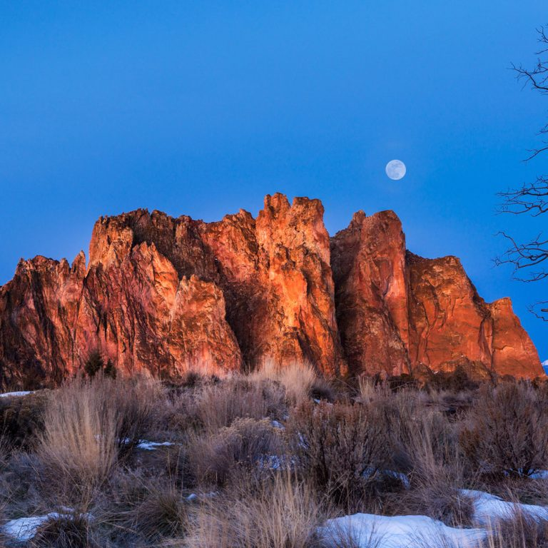 The moon rising over Smith Rock State Park