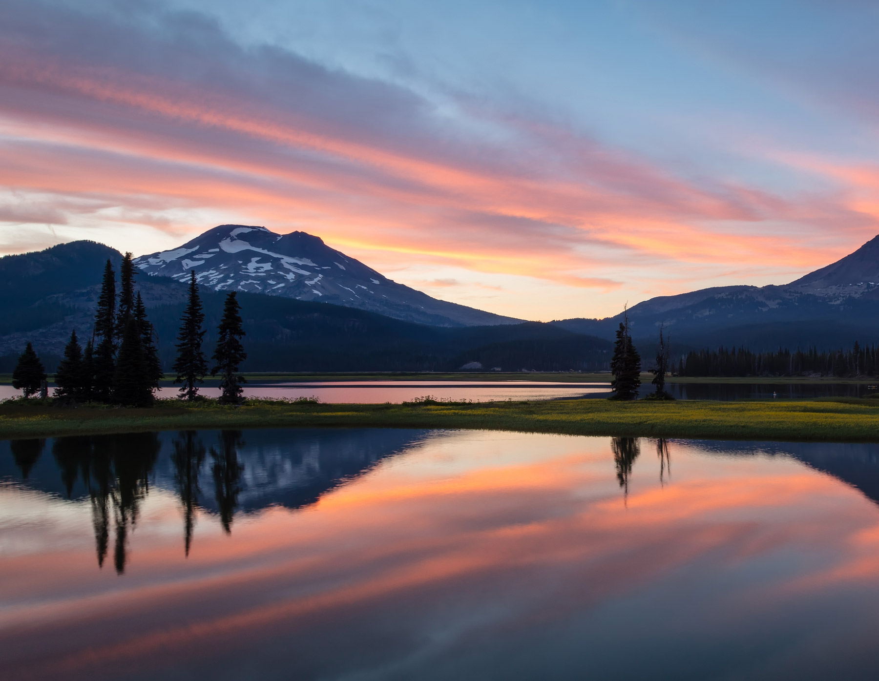 Sunset mountain view over water; central oregon real estate